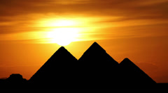 Sun goes behind great pyramids in Giza valley during gorgeous sunset, Egypt Stock Footage
