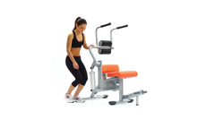 Slim woman on hydraulic exerciser Stock Footage