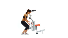 Slim young woman on hydraulic exerciser Stock Footage