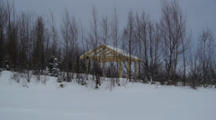 Park Shelter Surrounded by Snow and Barren Trees Stock Footage