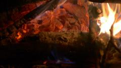 Log fire at night close up tracking left Stock Footage