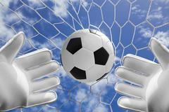 Soccer ball in goal net with blue sky Stock Photos