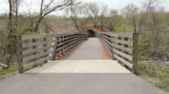 Pedestrian bridge leads to Rainbow tunnel. Stock Footage