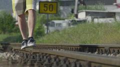 CLOSE UP: Walking on railroad tracks - stock footage