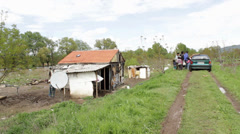 Serbia,2014.Floods. Evacuation poor family.Pan from slum to polluted river coast Stock Footage