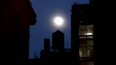 Water tower at the roof of the NYC building at night. Stock Footage