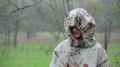 Military Murderer Man in a Hood with Blood Stock Footage
