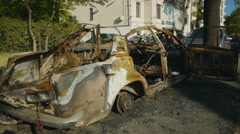 Side view of explosed and burnt car. Fatal damage. Stock Footage
