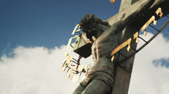 Crucifixion. Christian cross with Jesus Christ statue Stock Footage