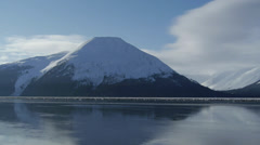 Snowy Mountain Reflected in Calm Water Stock Footage