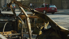 Fatal damaged car on a street with a car traffic on a bacground. DoF. Stock Footage