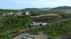 Aerial View: Mezhdurechensk coal mining. Mountain Shoria, South Siberia, Russia. Stock Footage