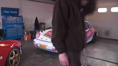 Timelapse pit lane racing car Stock Footage