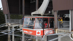Close angle grouse mountain cable car skyride arrives Stock Footage