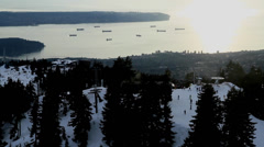 Aerial of skiers at grouse - vancouver backdrop Stock Footage