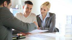 Couple signing construction contract Stock Footage