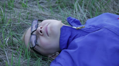 Girl Lying on the Grass and Twitches Stock Footage