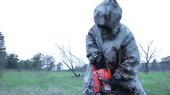 Chainsaw Maniac Murderer in the Hood with the Blood of Man Saws - stock footage