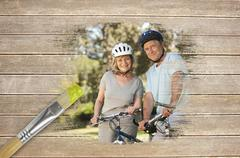 Composite image of senior couple on bikes in the park Piirros