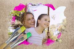 Composite image of mother and daughter in the park Piirros