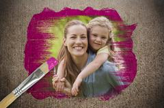 Composite image of mother and daughter with paintbrush dipped in pink paint Stock Illustration