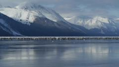 Pan Left Snowy Mountains, Reflected in Water - stock footage