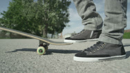Stock Video Footage of CLOSE UP: Skater playing with his skateboard
