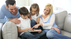 Family relaxing and using digital tablet Stock Footage