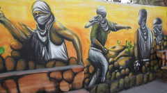 Sami Aldeek Paints a mural in Kalandia Stock Footage