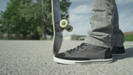 Stock Video Footage of SLOW MOTION CLOSEUP: Skateboarder spinning his skate