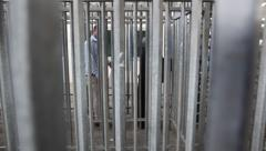 Palestinian cross Qalandia Checkpoint in a cage-like structure Stock Footage