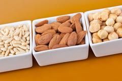 Peanuts aldons and hazelnuts - stock photo