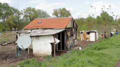Serbia,2014. After floods ruined house of poor family. People sitting on rampart Stock Footage