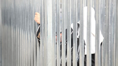 Stock Video Footage of Palestinian cross Qalandia Checkpoint in a cage-like structure