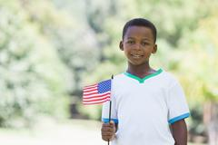 Stock Photo of Little boy celebrating independence day in the park