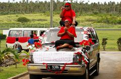 people celebrate arriving fuifui moimoi on vavau island, tonga - stock photo
