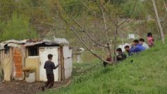 Serbia,2014.Floods. Poor gypsy families sitting on embankment above flooded slum Stock Footage