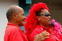 people celebrate arriving fuifui moimoi on vavau island, tonga - stock photo