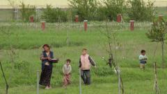 Serbia,2014. Floods. Mother and children bringing water in pot,poverty,homeless. - stock footage