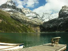 Chair on a wooden pier, lake o'hara, yoho national park, canada Stock Photos