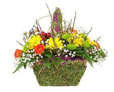 flowers bouquet arrangement centerpiece in wicker basket. - stock photo