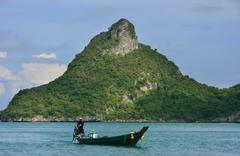longtail boat at ang thong national marine park, thailand - stock photo