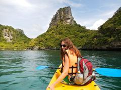 Young woman kayaking in ang thong national marine park, thailand Stock Photos