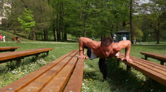 Sports man doing push ups on bench Stock Footage