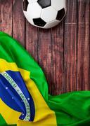 soccer: brasil flag and ball background - stock photo