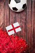 Stock Photo of soccer: england flag and poms background
