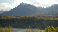Pan Right Snow-Capped Mountains Fall Colors Foreground Stock Footage