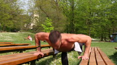 Close up of sports man doing push ups on bench Stock Footage