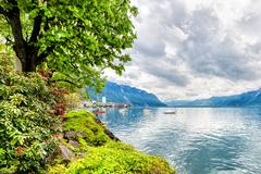 Flowers and trees near lake, Montreux. Switzerland - stock photo