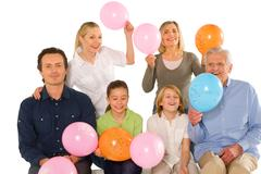 Family birthday party with baloons Stock Photos